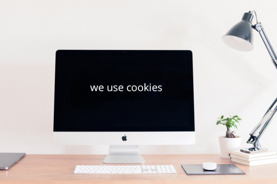a laptop with a black screen and text: we use cookies